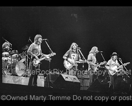 Photos of Randy Meisner, Glenn Frey, Don Felder and Joe Walsh of The Eagles Performing in Concert in 1976 by Marty Temme