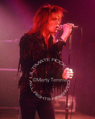Photo of vocalist Shane of Electric Angels in concert in 1988 by Marty Temme