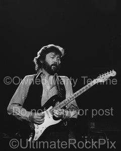 Black and white photo of Eric Clapton playing his black Stratocaster in 1979 by Marty Temme