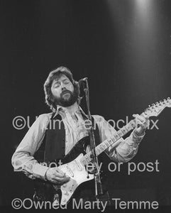 Black and White Photos of Eric Clapton Playing his Black Stratocaster in 1979 by Marty Temme