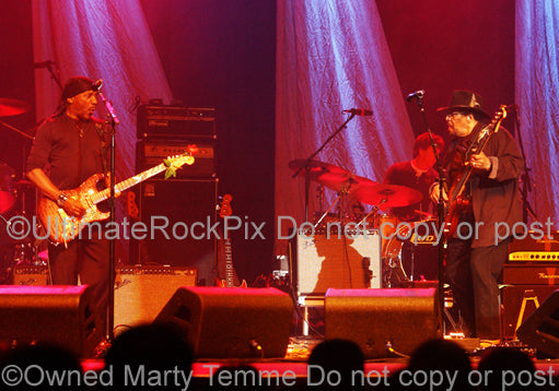 Photo of Jimi Hendrix alumni Ernie Isley and Billy Cox in performing together in concert by Marty Temme