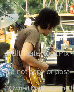 Photo of Mike Bloomfield of Electric Flag playing his 1959 Les Paul in 1974 by Marty Temme