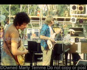 Photo of Mike Bloomfield, Roger Troy and Barry Goldberg of Electric Flag in 1974 by Marty Temme