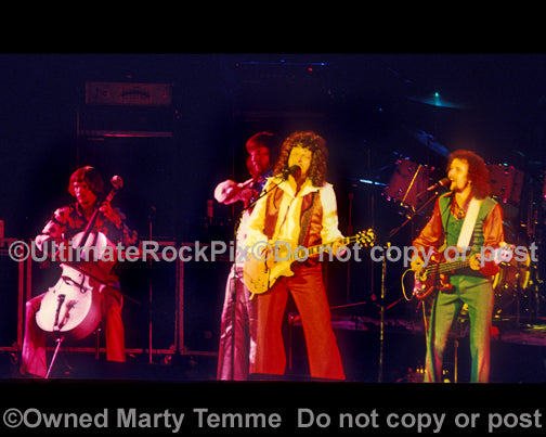 Photo of Hugh McDowell, Jeff Lynne and Kelly Groucutt of ELO in 1975 by Marty Temme