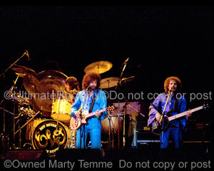 Photo of Jeff Lynne, Bev Bevan and Kelly Groucutt of ELO in 1977 by Marty Temme