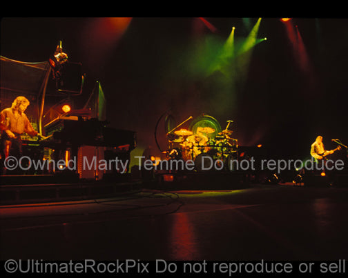 Photo of Keith Emerson, Greg Lake and Carl Palmer in concert in 1992 by Marty Temme