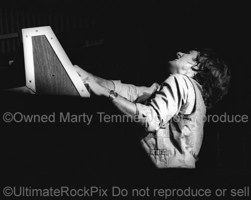 Photo of Keith Emerson of Emerson, Lake and Palmer playing organ in concert in 1977 by Marty Temme