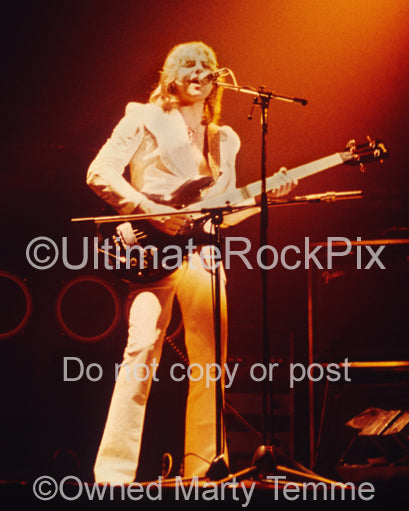 Photo of Greg Lake of Emerson, Lake & Palmer in concert in 1975 by Marty Temme