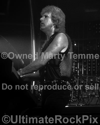Black and white photo of Keith Emerson of ELP playing organ in concert in 1992 by Marty Temme