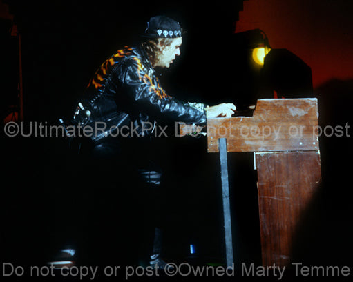 Photo of Keith Emerson of ELP playing organ in concert in 1992 by Marty Temme