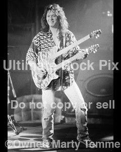 Black and White Photos of Eddie Van Halen of Van Halen Playing a Doubleneck Guitar in Concert in 1991 by Marty Temme