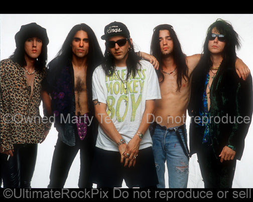 Photo of Eric Stacy, Greg Steele, Taime Downe, Brent Muscat and Brett Bradshaw of Faster Pussycat during a photo shoot in 1990 by Marty Temme