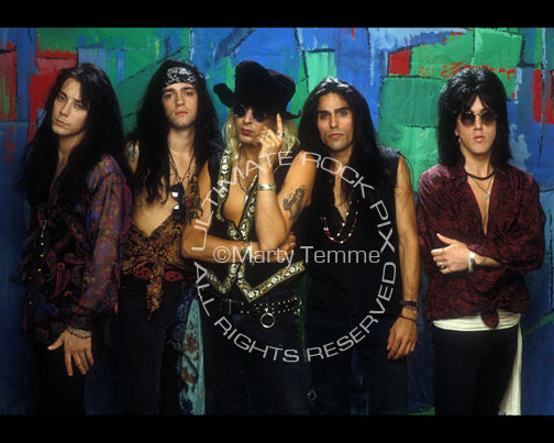 Photo of Taime Downe, Eric Stacy, Greg Steele, Brent Muscat and Brett Bradshaw of Faster Pussycat in 1990 by Marty Temme