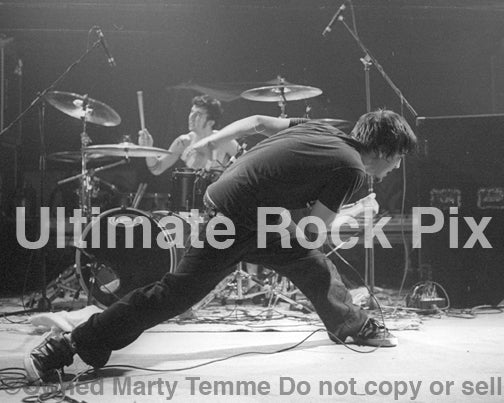 Black and white photo of Nate Barcalow of Finch in concert in 2002 by Marty Temme