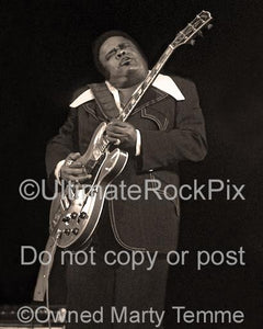 Black and white photo with sepia tint of Freddie King in concert in 1973 by Marty Temme