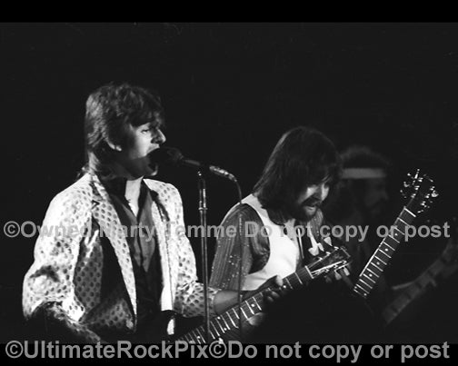 Photo of Dave Peverett and Rod Price of Foghat in concert in 1980 by Marty Temme