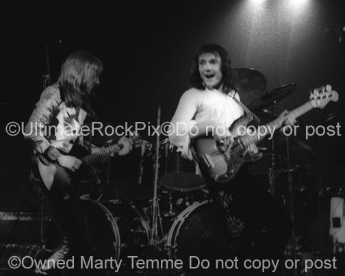 Photo of Dave Peverett and Tony Stevens of Foghat in concert in 1973 by Marty Temme