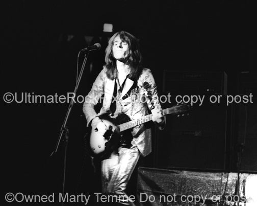 Photo of Dave Peverett of Foghat in concert in 1973 by Marty Temme