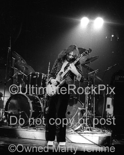 Photo of guitarist Rod Price of Foghat in concert in 1973 by Marty Temme