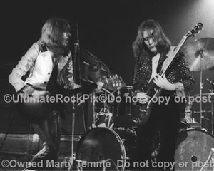 Photo of Dave Peverett and Rod Price of Foghat in concert in 1973 by Marty Temme