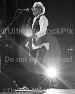 Black and white photos of Mick Jones of Foreigner in concert by Marty Temme
