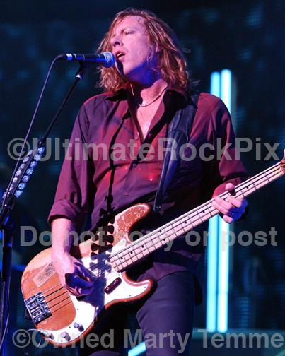 Photos of Bass Player and Singer Jeff Pilson of Foreigner in Concert in 2010 by Marty Temme