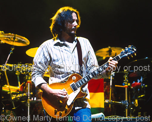 Photo of guitarist Marc Ford of Ben Harper in concert in 2004 by Marty Temme