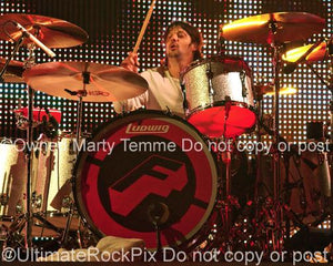 Photos of Drummer Jason Sutter of Foreigner and Chris Cornell Performing in Concert in 2010 by Marty Temme
