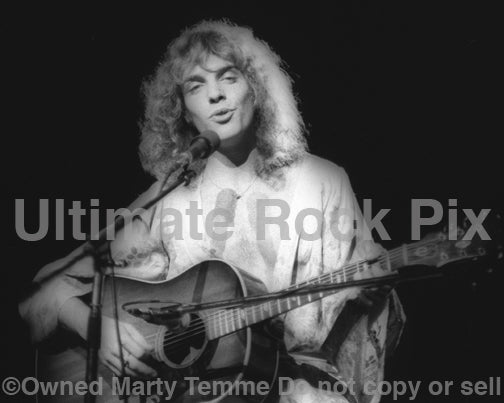 Black and white photo of Peter Frampton in concert in 1976 by Marty Temme