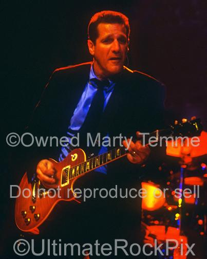 Photo of Glenn Frey of The Eagles playing a Les Paul in concert by Marty Temme