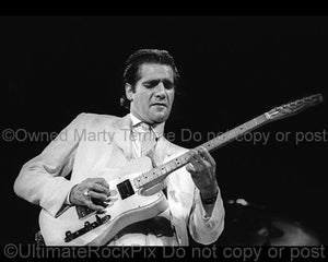 Photo of Glenn Frey of The Eagles playing a Fender Telecaster in concert in 1985 by Marty Temme