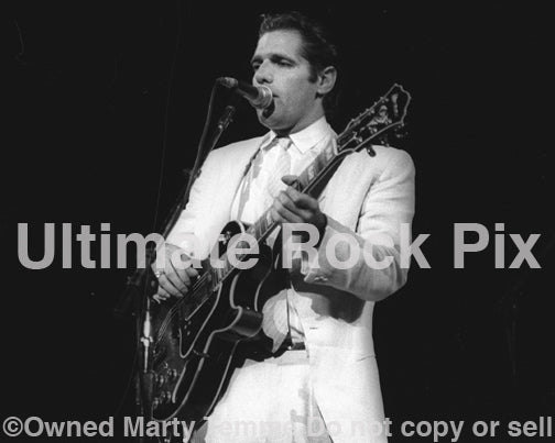 Photo of Glenn Frey of The Eagles in concert in 1985 by Marty Temme