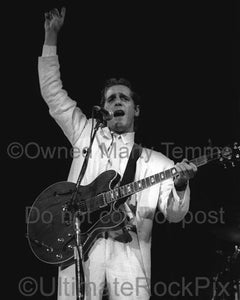 Photos of Musician Glenn Frey of The Eagles Singing and Playing Guitar in Concert in 1985 by Marty Temme