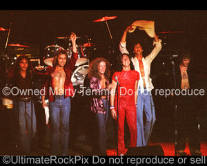 Photo of Lou Gramm and Foreigner in concert in 1977 by Marty Temme