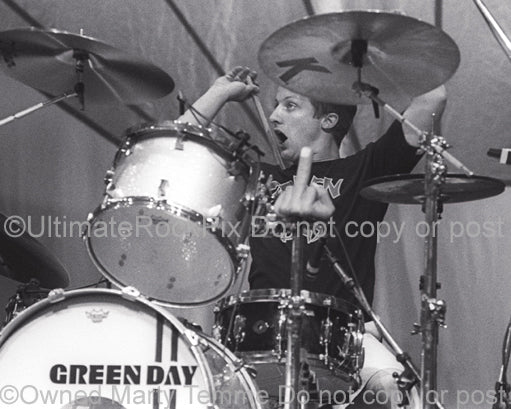 Photo of drummer Tre Cool of Green Day in concert by Marty Temme