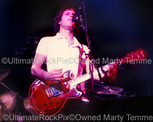 Photo of Bob Weir of The Grateful Dead playing an Ibanez guitar in 1983 by Marty Temme
