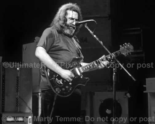 Black and white photo of Jerry Garcia of The Grateful Dead in concert by Marty Temme