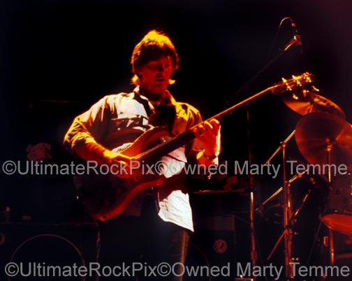 Photos of Phil Lesh of The Grateful Dead in Concert in the 1980's by Marty Temme