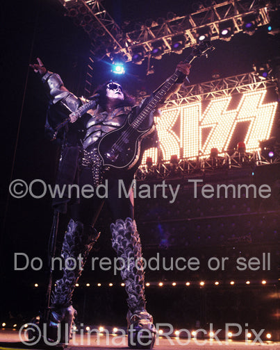 Photo of bass player Gene Simmons in concert by Marty Temme
