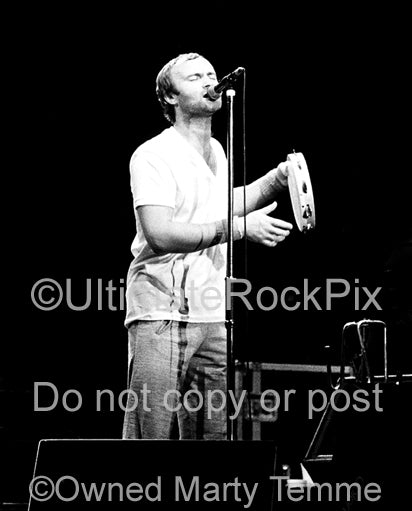 Photo of Phil Collins of Genesis singing in concert 1978 by Marty Temme