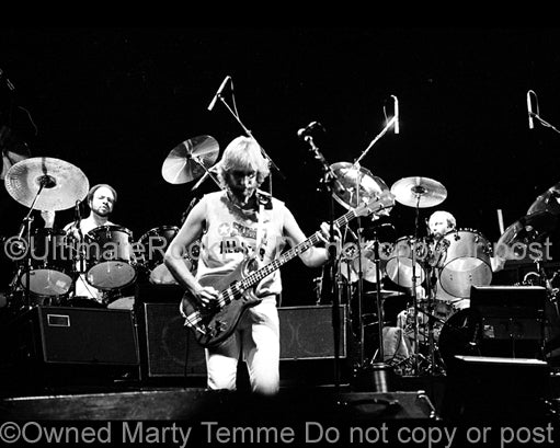 Photo of Phil Collins, Mike Rutherford and Chester Thompson of Genesis in 1978 by Marty Temme