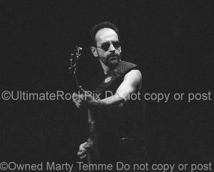 Photos of Mel Schacher of Grand Funk Railroad in Concert Performing in 1999 by Marty Temme