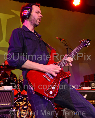 Photo of Paul Gilbert playng an Ibanez guitar in concert in 2012 by Marty Temme