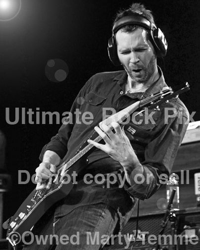 Black and white photo of guitar player Paul Gilbert of Mr. Big performing in concert in 2012 by Marty Temme