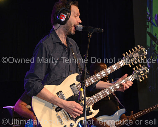 Photo of Paul Gilbert of Mr. Big playing a doubleneck Ibanez in concert in 2012 by Marty Temme