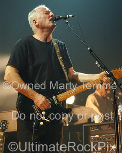Photo of David Gilmour singing in concert by Marty Temme