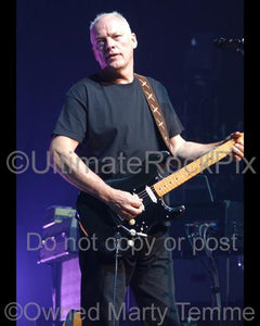 Photos of Guitar Player David Gilmour Playing his Fender Stratocaster in Concert by Marty Temme