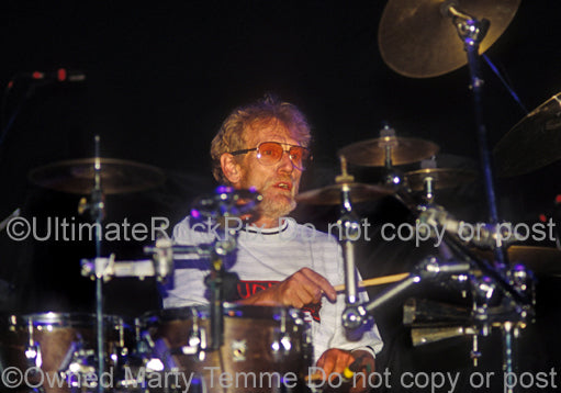 Photo of Ginger Baker of Cream and Blind Faith in concert in 1993 by Marty Temme