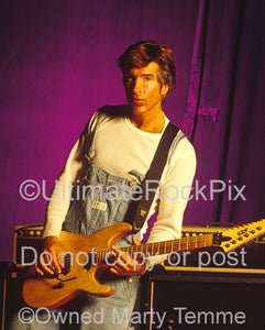 Photo of George Lynch holding a ESP guitar during a photo shoot in 1995 by Marty Temme
