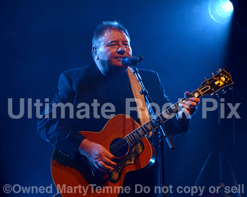 Photo of Greg Lake of Emerson, Lake and Palmer and King Crimson playing a Gibson J-200 in concert in 2012 by Marty Temme